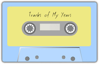 A blue cassette with a yellow sticker and the words Tracks of My Years on it