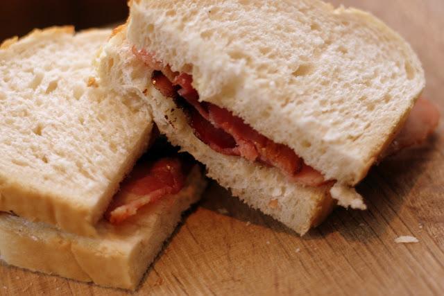 A bacon sandwich on white bread
