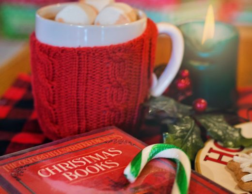 Christmas story book and a cup of hot chocolate with marshmallows