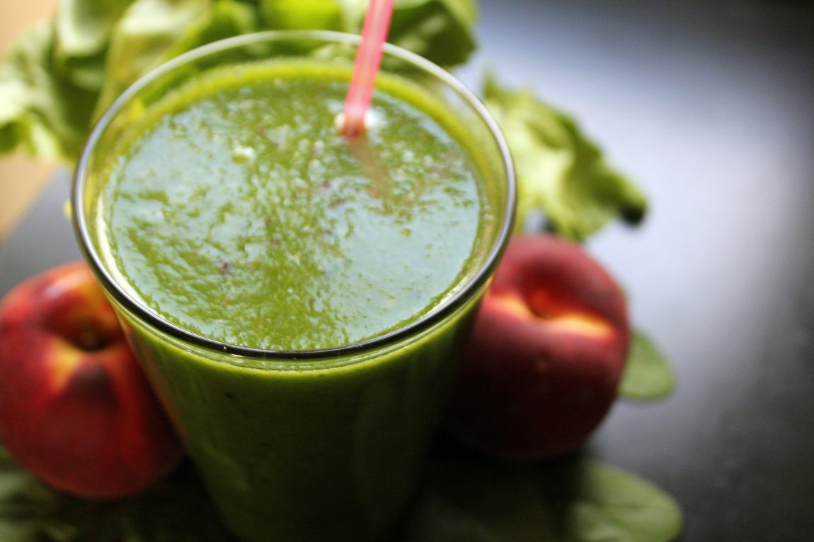 A healthy fruit and vegetable protein shake - green in colour
