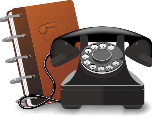 A old fashioned phone and brown phone book
