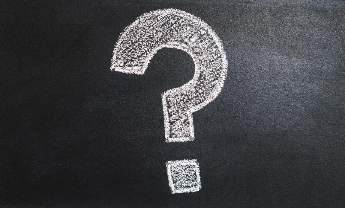 a question mark drawn in chalk on a blackboard