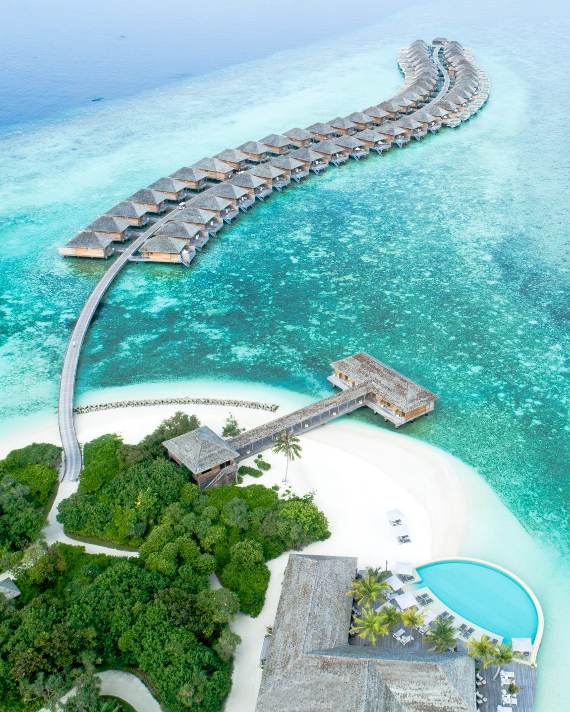 Ariel view of an exotic honeymoon resort, a string of apartments that are in the sea