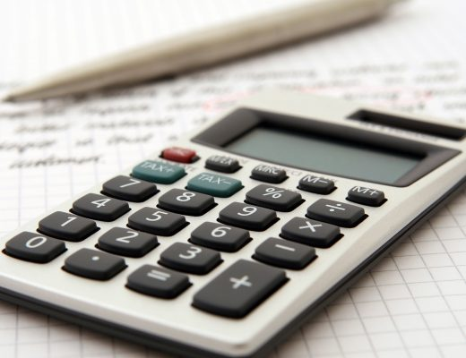 a calculator sat on top of a piece of paper