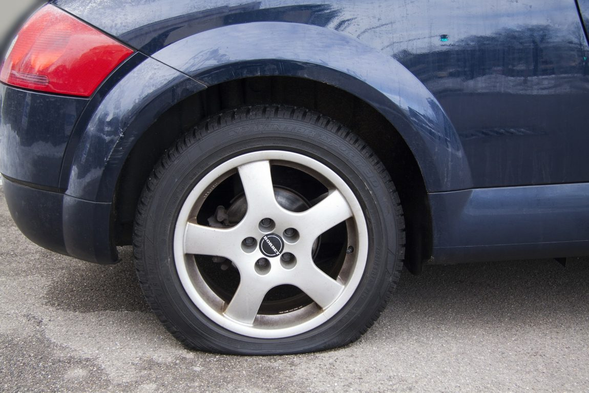 A car with a flat tyre