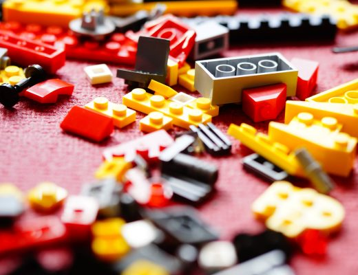 lots of lego bricks on a red carpet
