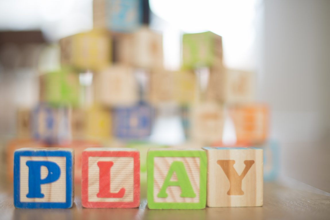 wooden blocks spelling the word play