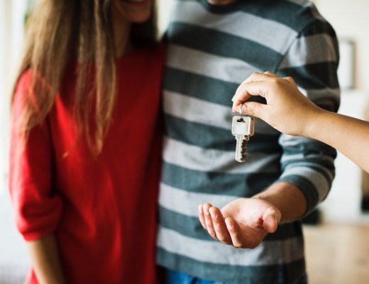 A couple being given their new home keys