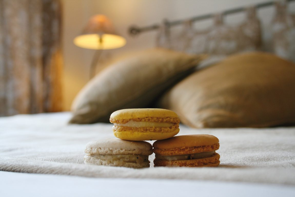 three macarons sat on top of a bed