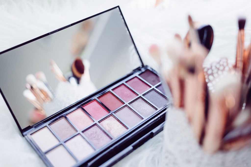 an eye shadow compact and make up brushes
