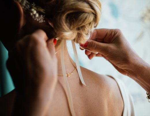 a bride having ribbon tied in her hair