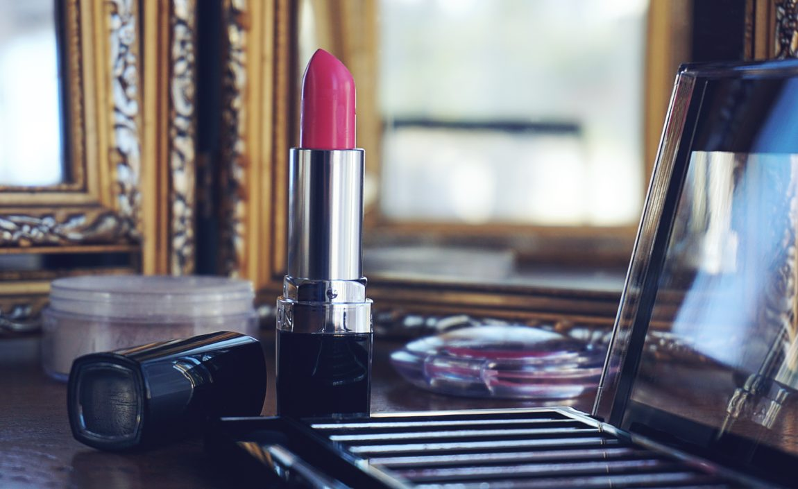 make up and red lip stick